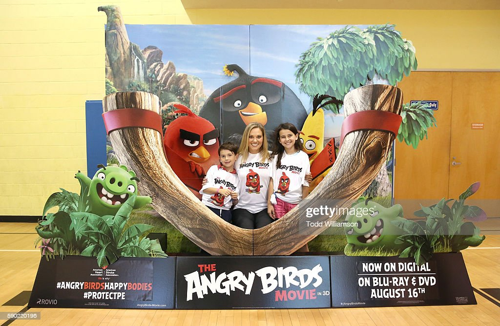 Kids With Heart Ambassador Michael Elhers Olympian Chloe Sutton and AHA Kids With Heart Ambassador Grace Elhers attend The Angry Birds Movie and...