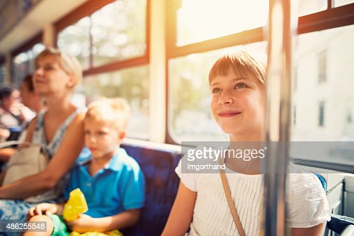 Kids with mother travelling by public transport bus
