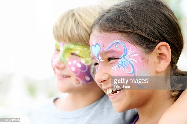 Kids with painted faces smiling