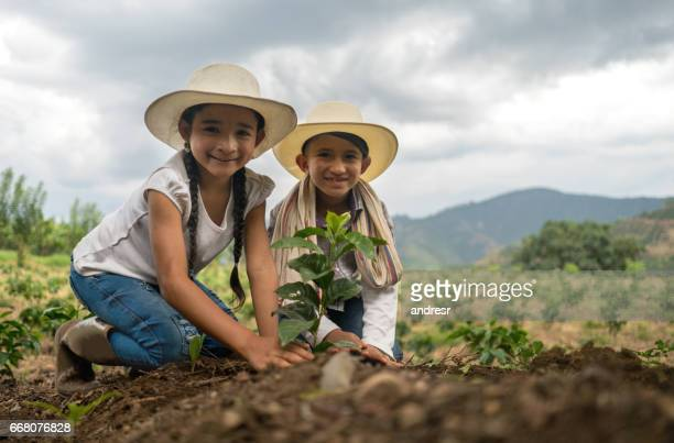 Kids working the land at a farm - agriculture concepts