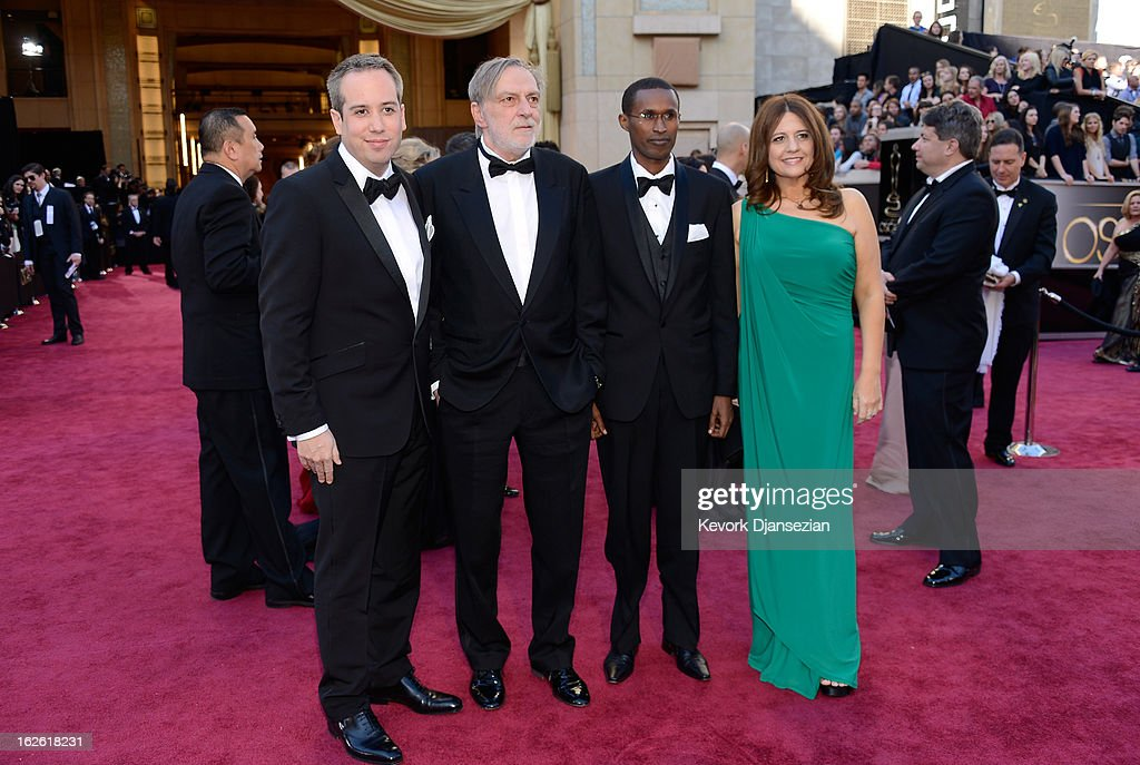 Kief Davidson, Dr Gino Strada, Dr Emmanuel Rusingiza and Cori Shepherd Stern arrive at the Oscars at Hollywood & Highland Center on February 24, 2013 in Hollywood, California.