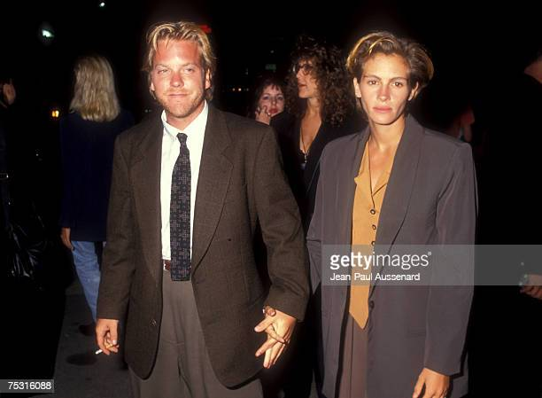 Kiefer Sutherland and Julia Roberts arriving at Mann's Chinese Theatre in Hollywood CA 1990