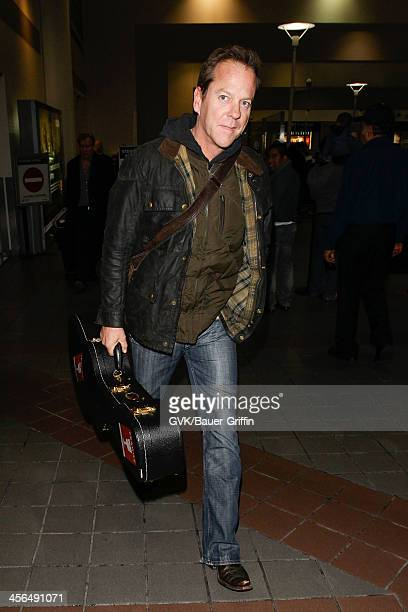 Kiefer Sutherland is seen at LAX airport on December 13 2013 in Los Angeles California