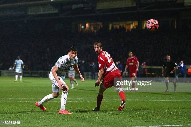 Kieffer Moore of Yeovil scores his sides second goal as Rob Atkinson of Accrington looks on during the FA Cup Second Round Replay match between...