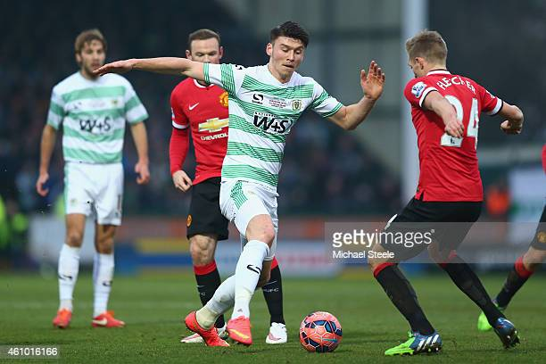 Kieffer Moore of Yeovil Town runs at Darren Fletcher of Manchester United during the FA Cup Third Round match between Yeovil Town and Manchester...