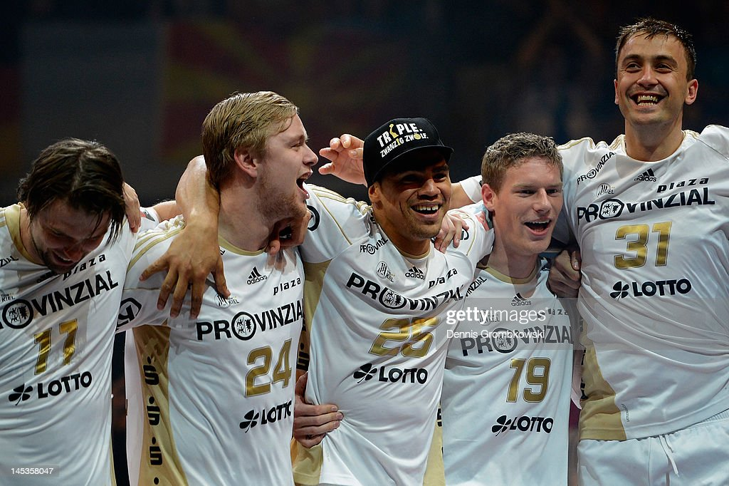 Kiel players celebrate after the EHF Final Four final match between THW Kiel and BM Atletico Madrid at Lanxess Arena on May 27, 2012 in Cologne, Germany.