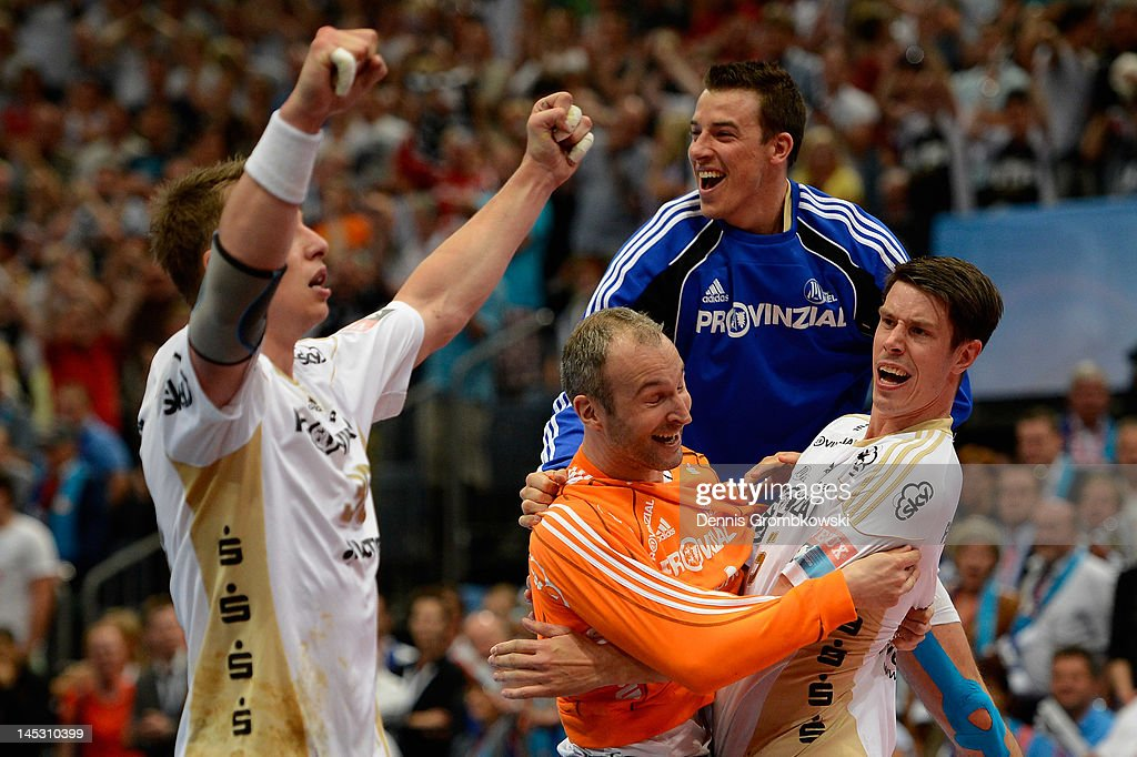 Kiel players celebrate after the EHF Final Four semi final match between Fuechse Berlin and THW Kiel at Lanxess Arena on May 26, 2012 in Cologne, Germany.