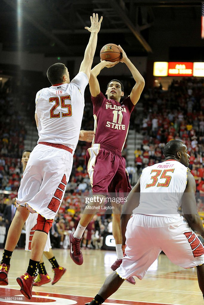 Kiel Turpin #11 of the Florida Seminoles takes a shot over Alex Len #25 of the Maryland Terrapins takes a shot during a college basketball game on January 9, 2013 at the Comcast Center in College Park, Maryland.