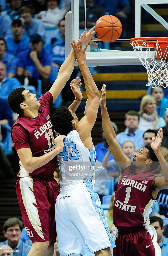 Kiel Turpin #11 of the Florida State Seminoles blocks a shot by James Michael McAdoo #43 of the North Carolina Tar Heels during play at Dean Smith Center on March 3, 2013 in Chapel Hill, North Carolina. North Carolina won 79-58.