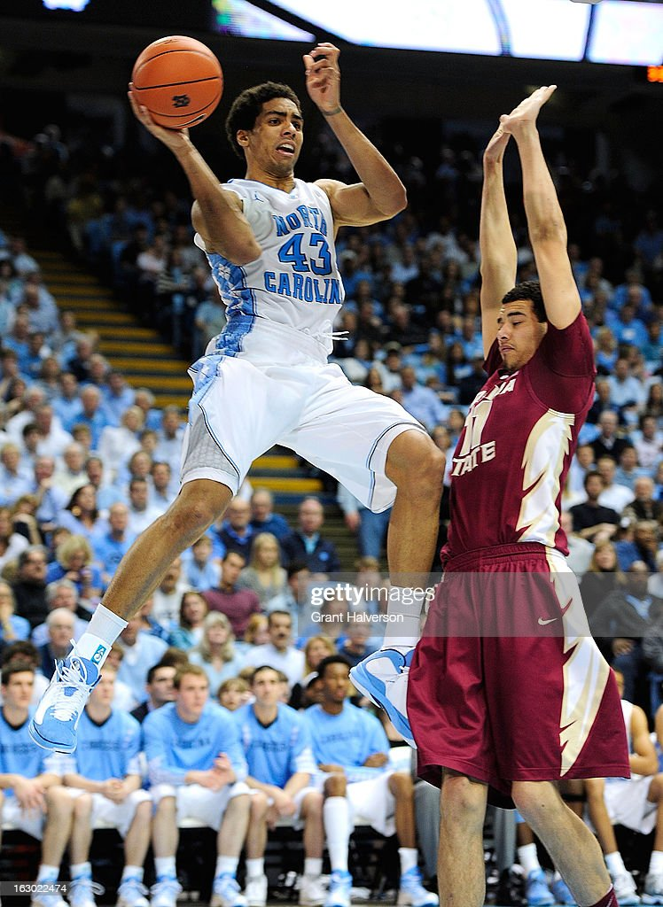 Kiel Turpin #11 of the Florida State Seminoles defends a baseline drive by James Michael McAdoo #43 of the North Carolina Tar Heels during play at Dean Smith Center on March 3, 2013 in Chapel Hill, North Carolina. North Carolina won 79-58.