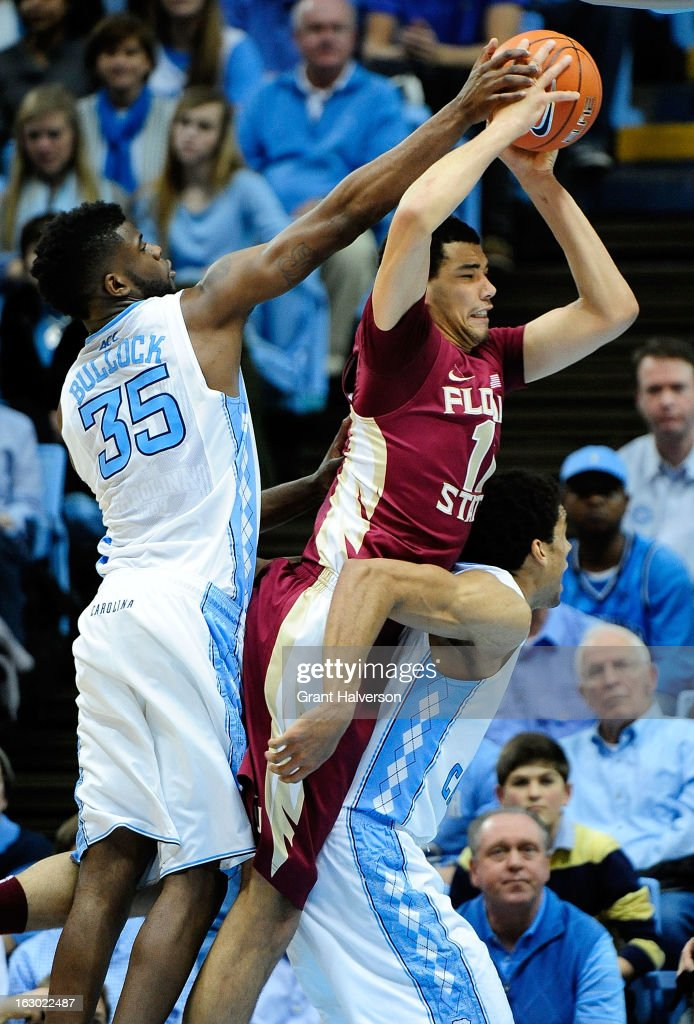 Kiel Turpin #11 of the Florida State Seminoles drives between Reggie Bullock #35 and James Michael McAdoo #43 of the North Carolina Tar Heels during play at Dean Smith Center on March 3, 2013 in Chapel Hill, North Carolina. North Carolina won 79-58.