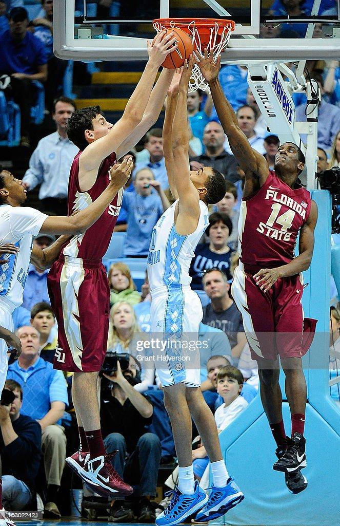 Kiel Turpin #11 of the Florida State Seminoles takes a rebound away from Brice Johnson #11 of the North Carolina Tar Heels during play at Dean Smith Center on March 3, 2013 in Chapel Hill, North Carolina. North Carolina won 79-58.