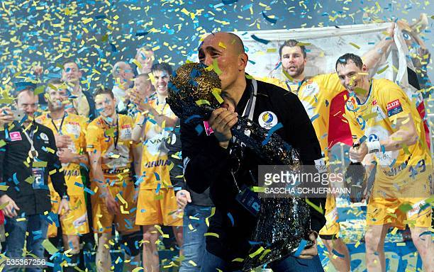 Kielce's headcoach Talant Dujshebaev celebrates with the trophy after winning the Handball EHF Champions League final Four Final match between KS...