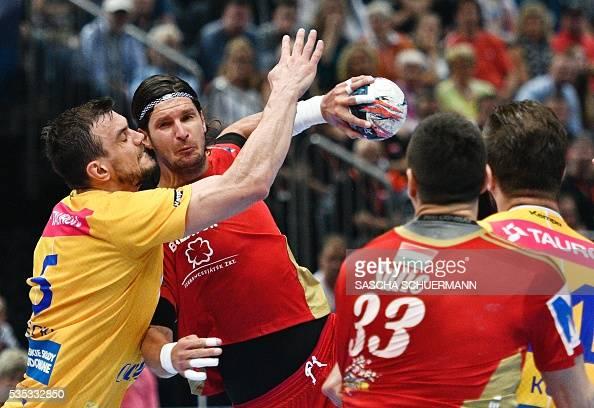 Kielce's Michal Jurecki and Veszprém's Laszlo Nagy vie for the ball during the Handball EHF Champions League final Four Final match between KS Vive...