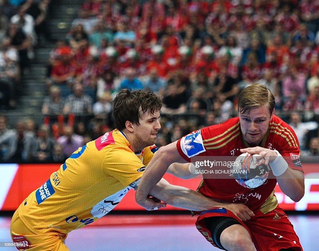 Kielce's Pawel Paczkowski (L) and Veszprém's Aron Palmarsson vie for the ball during the Handball EHF Champions League final Four Final match between KS Vive Tauron Kielce and MVM Veszprém in Cologne, western Germany, on May 29, 2016. / AFP / SASCHA