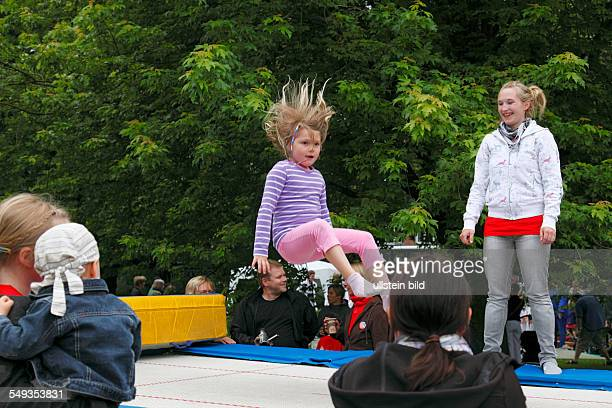 Kieler Woche 2011 Kiel Hiroshima Park childrens festival playground children girl jumping on a trampoline
