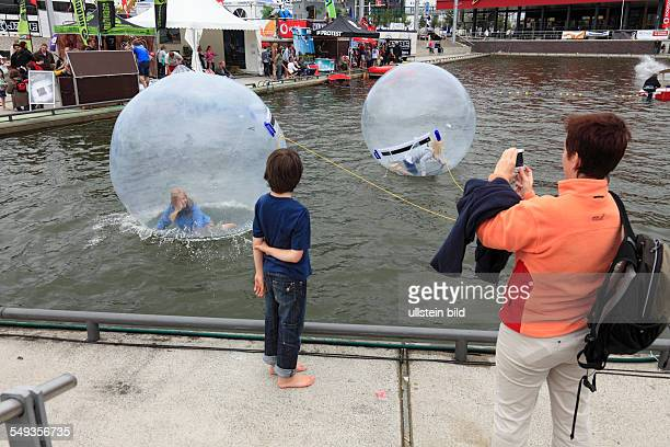 Kieler Woche 2011 sailing event summer fair childrens festival children playing in large balloon on the water surface
