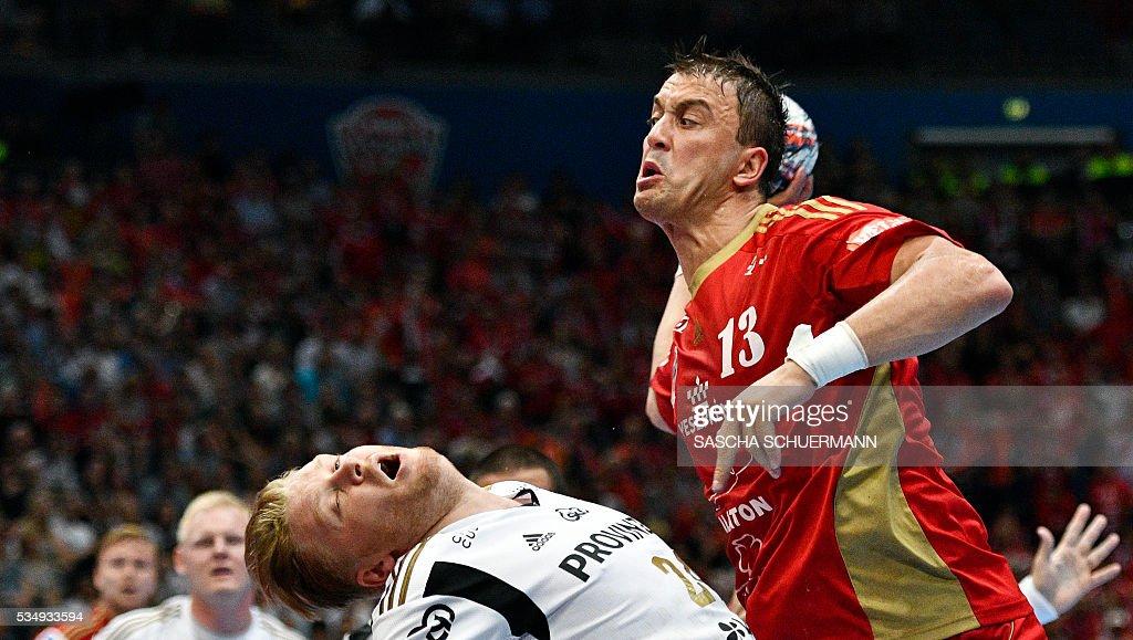 Kiel's Dener Jaanimaa and Veszprém's Momir Ilic (R) vie during the Handball EHF Champions League final Four semi-final match between THW Kiel and MVM Veszprem in Cologne, western Germany, on May 28, 2016. / AFP / SASCHA