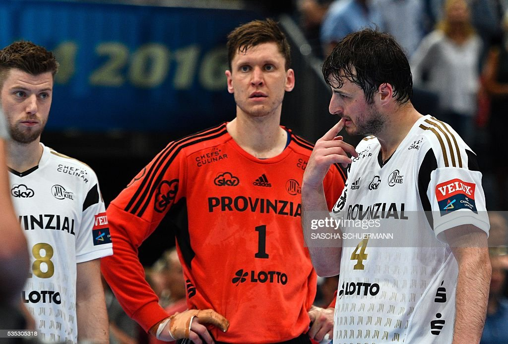 Kiel's Domagoj Duvnjak (R-L), Niklas Landin Jacobsen and Niclas Ekberg react after the Handball EHF Champions League final Four semifinal match between Paris St-Germain and THW Kiel in Cologne, western Germany, on May 29, 2016. / AFP / SASCHA