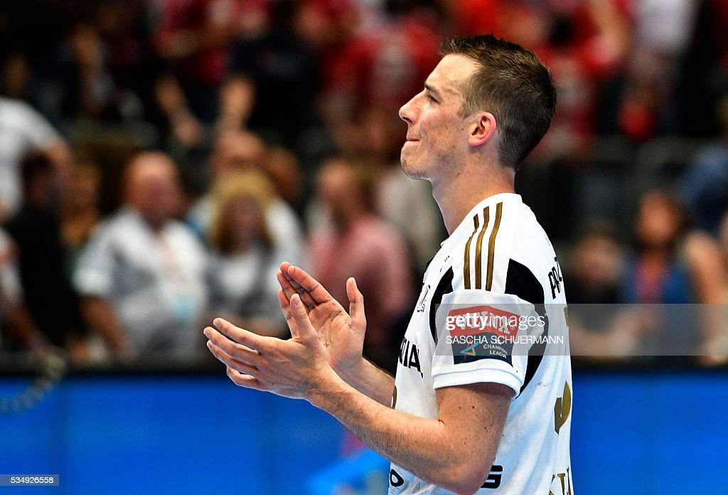 Kiel's Dominik Klein reacts after the Handball EHF Champions League final Four semi-final match between THW Kiel and MVM Veszprem in Cologne, western Germany, on May 28, 2016. / AFP / SASCHA