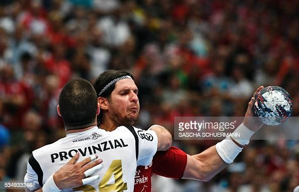 Kiel's Ilija Brozovic and Veszprém's Laszlo Nagy vie during the Handball EHF Champions League final Four semifinal match between THW Kiel and MVM...