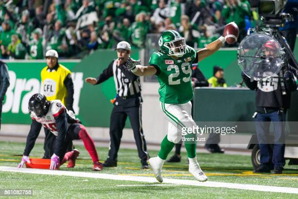 Kienan LaFrance of the Saskatchewan Roughriders after scoring a first half touchdown in the game between the Ottawa Redblacks and Saskatchewan...