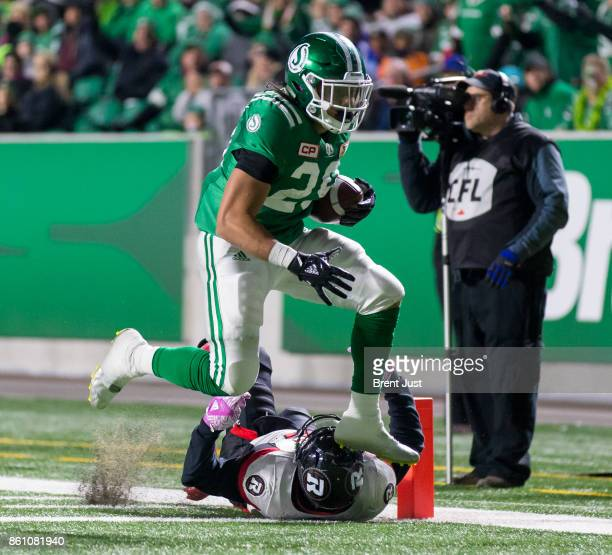 Kienan LaFrance of the Saskatchewan Roughriders scores a first half touchdown in the game against the Ottawa Redblacks at Mosaic Stadium on October...