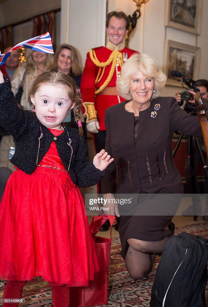 Kiera Holland 5 receives Christmas presents from the Duchess, including a Union Jack Flag as Camilla, Duchess of Cornwall, patron of the Helen & Douglas House and The London Taxidrivers' Fund invites underprivileged children from both charities to decorate the Christmas tree and join the Duchess for Christmas lunch at Clarence House on December 15, 2015 in London, England.
