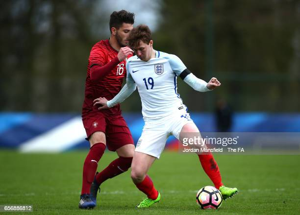 Kieran Dowell of England holds off Pedro Pacheco of Portugal during the UEFA U20 International Friendly match between England and Portugal at Stade...