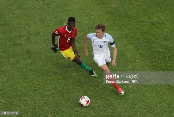 Kieran Dowell of England is chased by Ibrahima Sory of Guinea during the FIFA U20 World Cup Korea Republic 2017 group A match between England and...