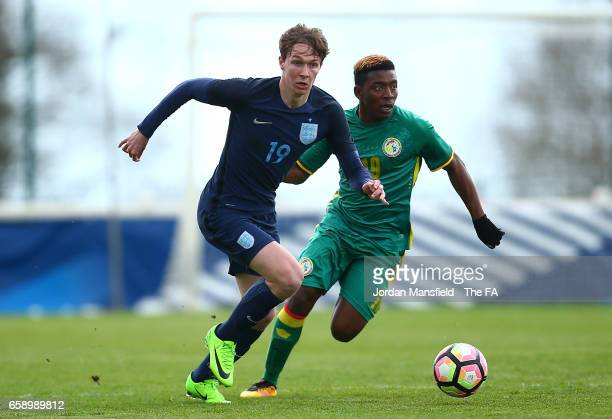 Kieran Dowell of England is chased down by Cheikh Ahmadou Bamba Kane of Senegal during the UEFA U20 International Friendly match between England and...