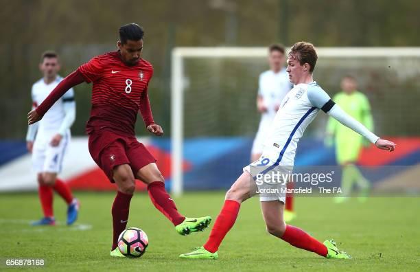 Kieran Dowell of England tackles Pedro Delgado of Portugal during the UEFA U20 International Friendly match between England and Portugal at Stade de...