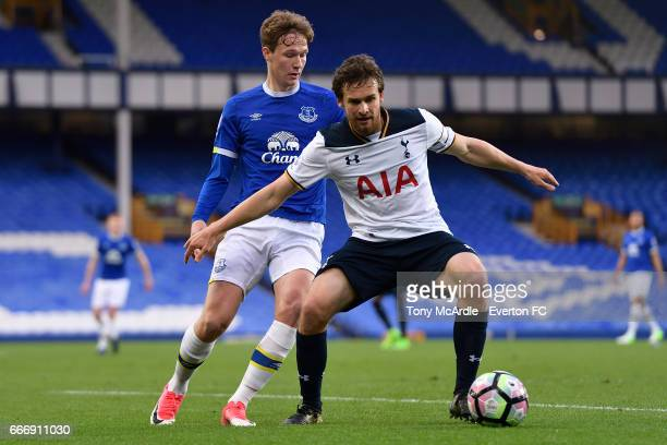 Kieran Dowell of Everton and Filip Lesniak challenge for the ball during the Premier League 2 match between Everton U23 and Tottenham Hotspur U23 at...
