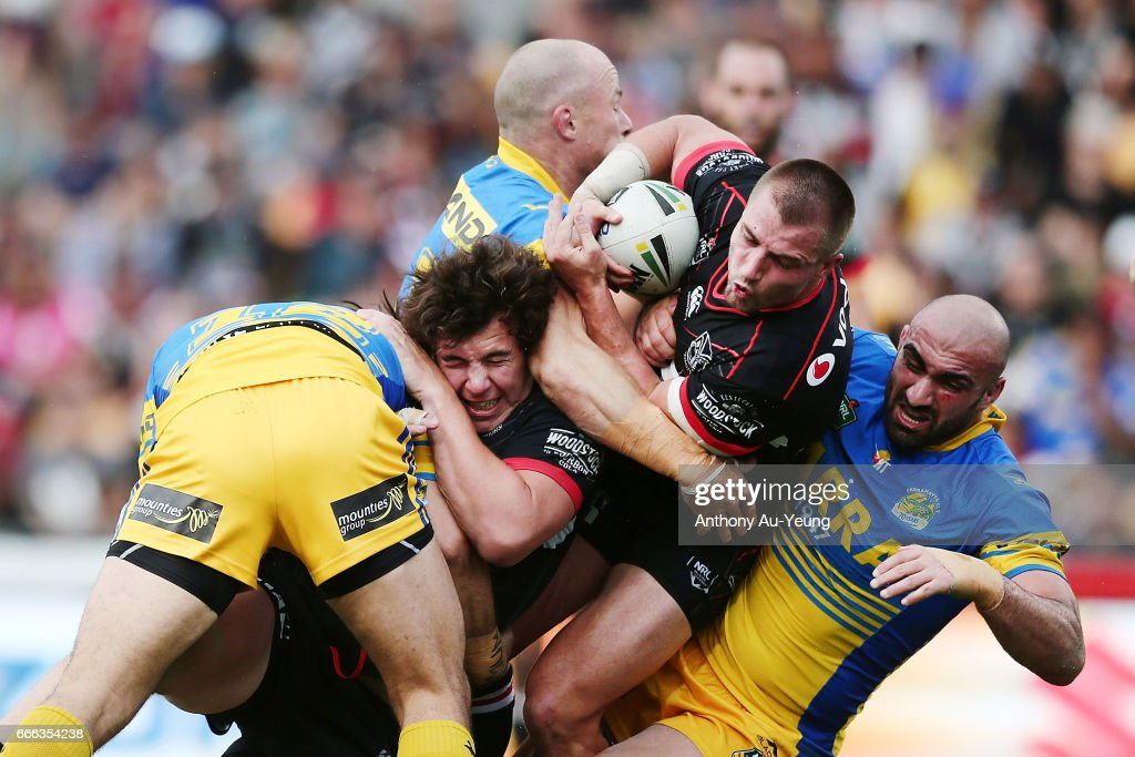 Kieran Foran and Charlie Gubb of the Warriors are tackled by Tepai Moeroa, Beau Scott and Tim Mannah of the Eels during the round six NRL match between the New Zealand Warriors and the Parramatta Eels at Mt Smart Stadium on April 9, 2017 in Auckland, New Zealand.