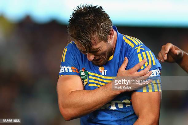 Kieran Foran of the Eels grimaces as he holds his shoulder during the round 11 NRL match between the Parramatta Eels and the Melbourne Storm at...