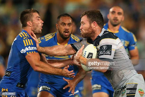 Kieran Foran of the Eels tackles Gavin Cooper of the Cowboys during the round two NRL match between the Parramatta Eels and the North Queensland...