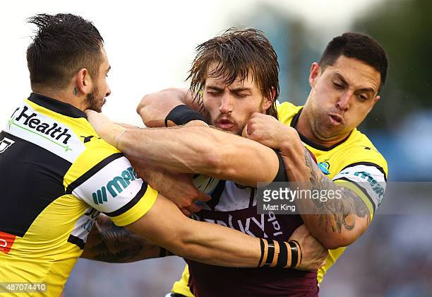 Kieran Foran of the Sea Eagles is tackled during the round 26 NRL match between the Cronulla Sharks and the Manly Sea Eagles at Remondis Stadium on...