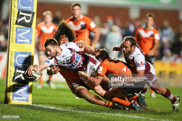 Kieran Foran of the Sea Eagles scores a try during the round 18 NRL match between the ManlyWarringah Sea Eagles and the Wests Tigers at Brookvale...