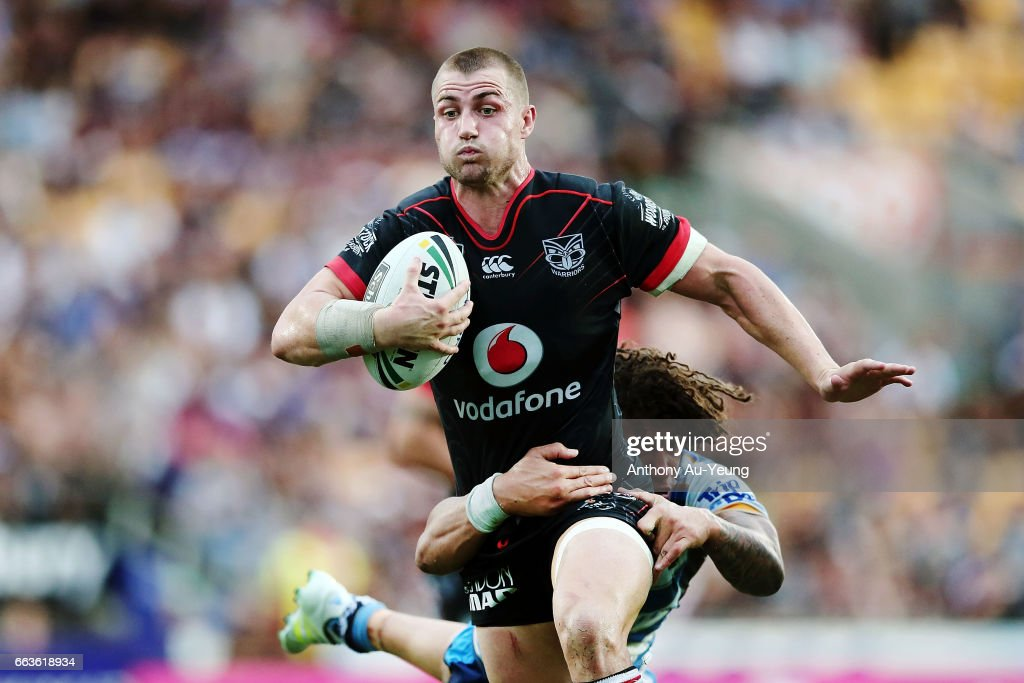 Kieran Foran of the Warriors beats the tackle from Kevin Proctor of the Titans to run in a try during the round five NRL match between the New Zealand Warriors and the Gold Coast Titans at Mt Smart Stadium on April 2, 2017 in Auckland, New Zealand.