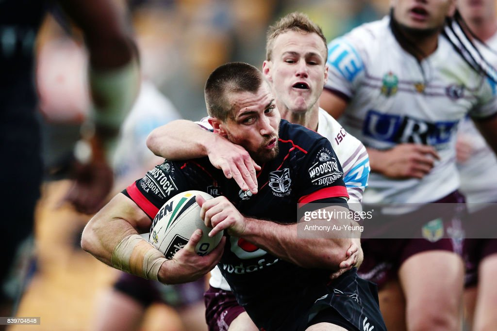 Kieran Foran of the Warriors is tackled by Daly Cherry-Evans of the Sea Eagles during the round 25 NRL match between the New Zealand Warriors and the Manly Sea Eagles at Mt Smart Stadium on August 27, 2017 in Auckland, New Zealand.