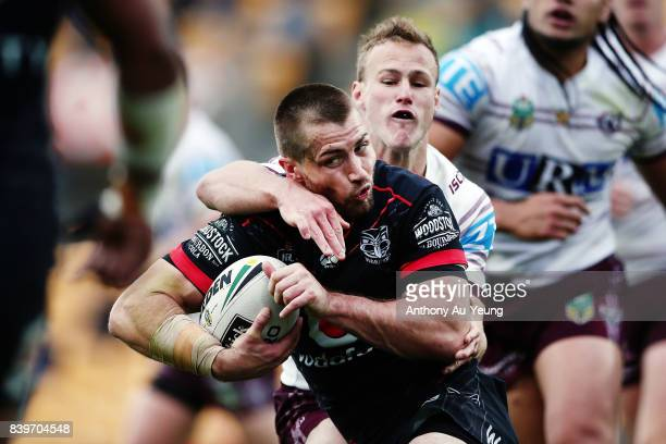 Kieran Foran of the Warriors is tackled by Daly CherryEvans of the Sea Eagles during the round 25 NRL match between the New Zealand Warriors and the...