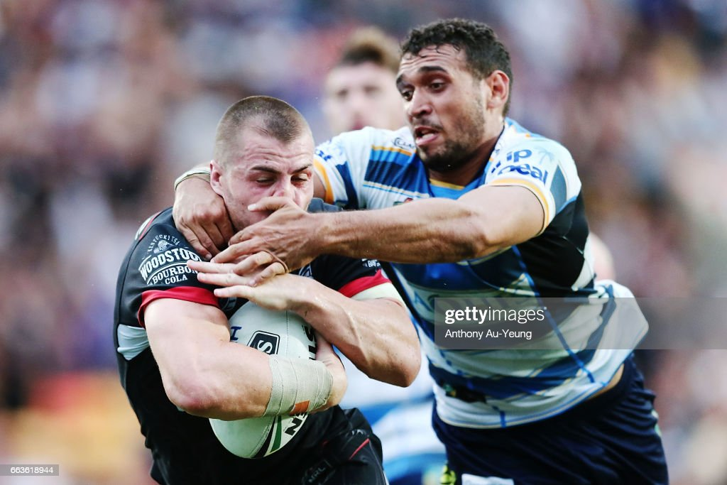 Kieran Foran of the Warriors is tackled by Tyronne Roberts Davis of the Titans during the round five NRL match between the New Zealand Warriors and the Gold Coast Titans at Mt Smart Stadium on April 2, 2017 in Auckland, New Zealand.