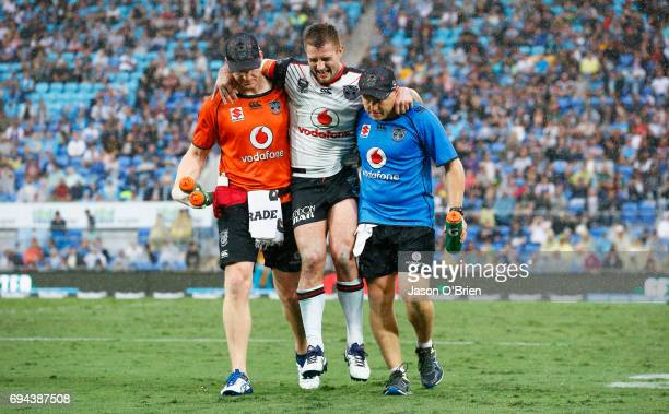 Kieran Foran of the Warriors suffers an injury during the round 14 NRL match between the Gold Coast Titans and the New Zealand Warriors at Cbus Super...