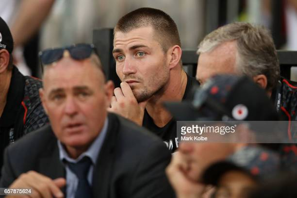Kieran Foran of the Warriors watches on from the grandstand after an injury sustained during the warmup for the round four NRL match between the St...