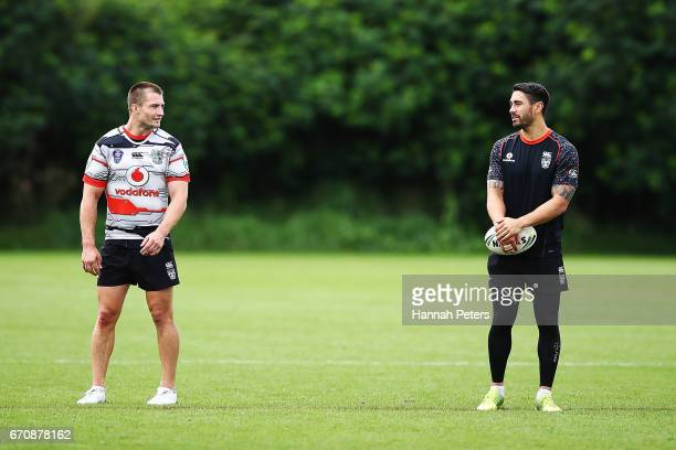 Kieran Foran talks with Shaun Johnson during a New Zealand Warriors NRL training session at Mt Smart Stadium on April 21 2017 in Auckland New Zealand