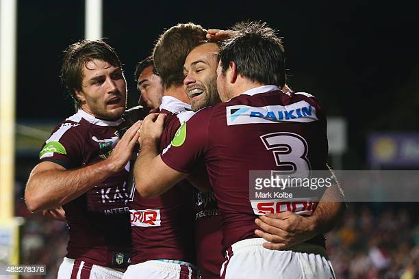 Kieran ForanPeter Hiku Daly CherryEvans Brett Stewart and Jamie Lyon of the Eagles celebrate a try during the round 22 NRL match between the Manly...