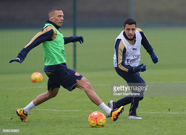 Kieran Gibbs and Alexis Sanchez of Arsenal during a training session at London Colney on January 21 2016 in St Albans England