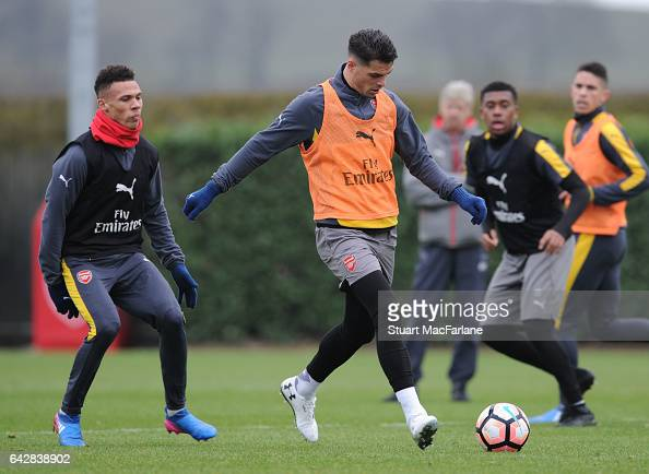 Kieran Gibbs and Granit Xhaka of Arsenal during a training session on February 19 2017 in St Albans England