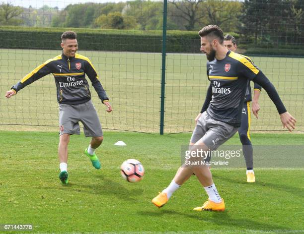 Kieran Gibbs and Olivier Giroud of Arsenal during a training session at London Colney on April 22 2017 in St Albans England