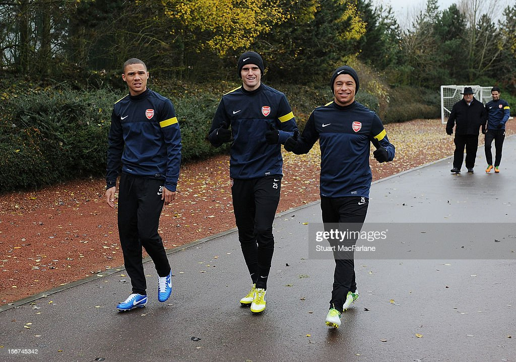Kieran Gibbs, Carl Jenkinson and Alex Oxlade-Chamberlain of Arsenal before a training session at London Colney on November 20, 2012 in St Albans, England.